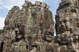 Closer view of several towers at Bayon, showing smiling faces looking out in all directions