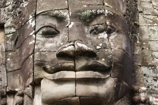 Close up of the details of a smiling Buddha-King face