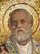 Close up of the mosaic head of St Nicholas with gold halo