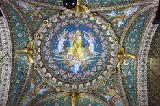 One of many mosaic images surrounded by ornately gilded mouldings and carvings in the Lyon Basilica