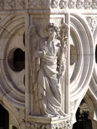 Sculpture of Archangel Gabriel on the corner of the Dog'e Palace, Venice