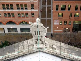 A very unhappy rear view of one of the sculpted decorations of St Paul's cathedral in London