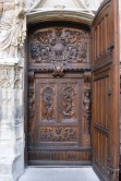 The solid walnut doors of St Pierre, Avignon, open directly into the nave of the church.