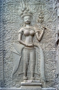 This is the only apsara out of nearly 2000 at Angkor Wat whose lips are parted, showing her teeth.