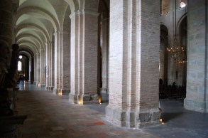 The colour of the brickwork has been lime-washed, which makes the interior of the basilica much lighter than it would have been if the brickwork was left its original red colour