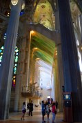 Every facet of the complex interior surfaces of the aisles of La Sagrada Familia in Barcelona is painted with colour from the richly chromatic windows.