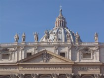 A few of the decorative sculptures over the entrance to St Peter's Cathedral in Rome