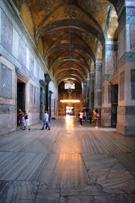In the arcades that surround the massive central prayer space of the great dome Basilica of Hagia Sophia, the walls and pillars are all clade in thin slices of variegated stone.