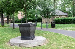 The drinking fountain with the Ossuary in the background