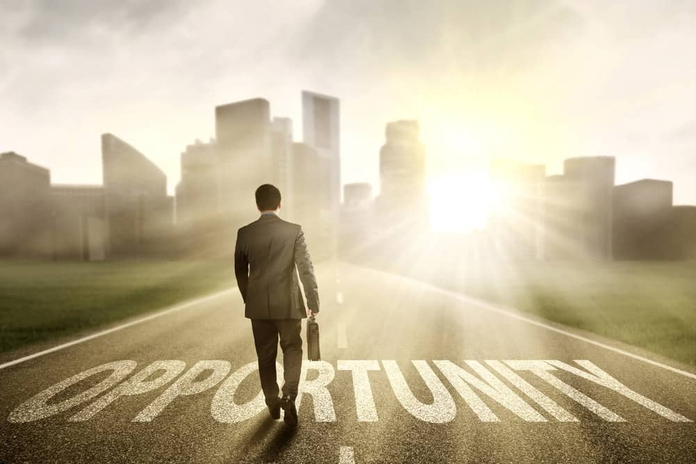 """Man walking on a road marked """"Opportunity."""" Maybe this is the opportunity you've been waiting for to take that next step in your life."""
