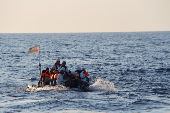 Rescuing the first people and bringing them safely back on board of Dignity I