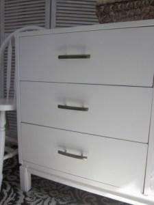 EntriWays.com; Modern white 6-drawer dresser with champagne bronze hardware