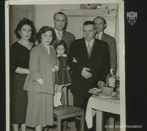 A photo of six people, including Holocaust survivor Jakob Mogilnik with five family members.