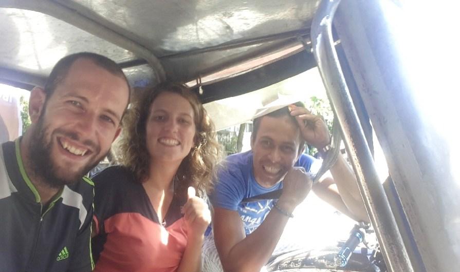 Un sympathique chauffeur de tricycle!