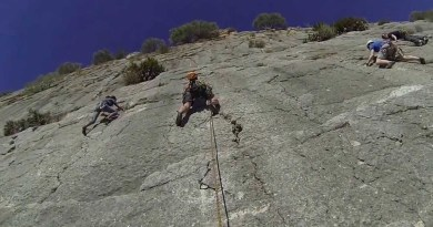 Three people rock climbing El Chorro in Spain