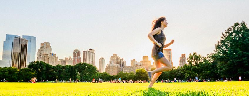 A girl runs in the city