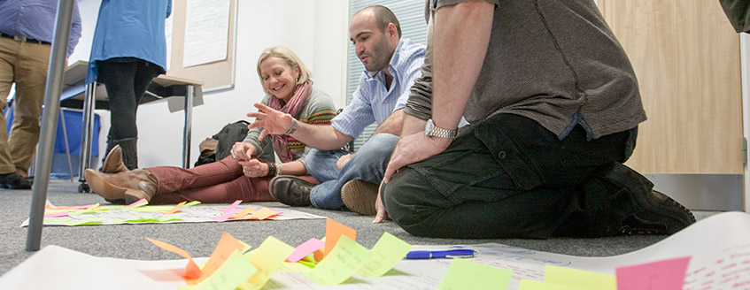participants use bright post its at the CSL workshop