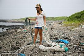 Angela Sun with Fishing Nets on Midway Island, Plastic Paradise LLC