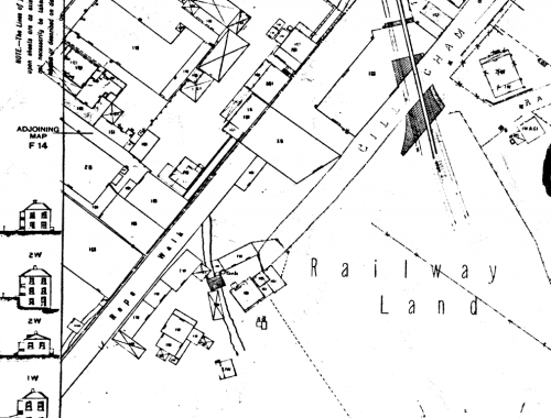 Survey map showing clusters of buildings on both sides of stream
