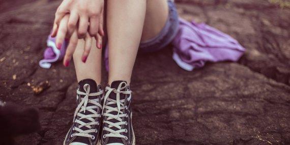 girl's legs wearing sneakers