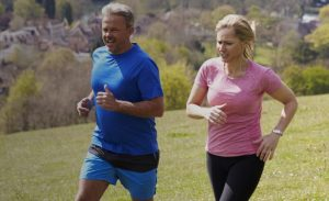 Image of two people exercising