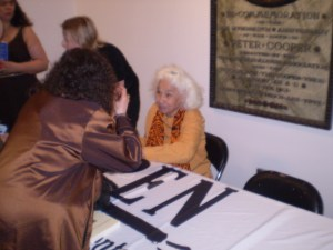 Artist remains vigilant even at Repose: Nawal signing books after the event.