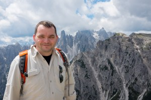 Daniel Apai at the Dolomites mountain range, that preserves a thick layer of Triassic coral reefs.
