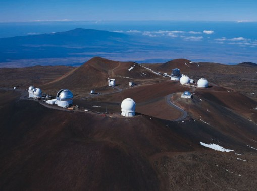 Observatories on the volcanic summit of Mauna Kea, the highest point in the state of Hawaii and a sacred mountain in Hawaiian religion. (Image credit UH/IFA)
