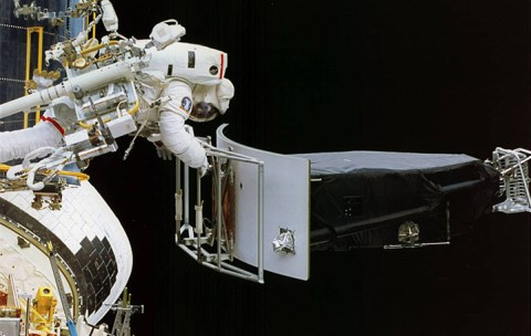 Astronaut Jeffrey Hoffman removes the Wide -Field and Planetary Camera 1 during the first Hubble repair mission, which corrected for the telescope's flawed mirror, in December 1993. Credit: NASA