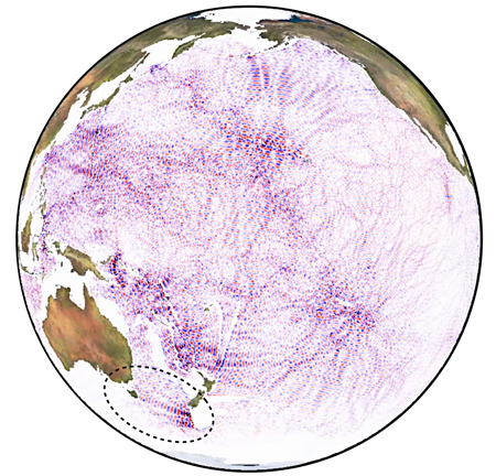 Fig. 1. Global numerical models of underwater tidal wave generation suggest that distinct tidal beams (pathways of tidal energy) cross the global ocean. Scientists have identified many of these, including the trans-Tasman beam (inside dotted circle), in satellite altimetry data. Here, tidal crests (red) and troughs (blue) are shown as a snapshot in time.