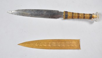 This dagger, recovered from King Tutankhamun's mummy, sports a rock crystal pommel, a golden hilt, and a blade hammered from meteoritic iron.