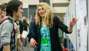 A student presents her research during an AGU Fall Meeting.