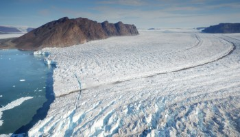 A large crack splits the ice about 100 meters from the face of Bowdoin Glacier.