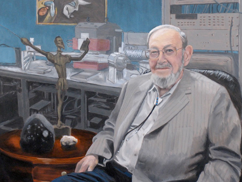 Gerald Wasserburg in front of the Lunatic I mass spectrometer with the Allende meteorite and a lunar rock on the table beside him
