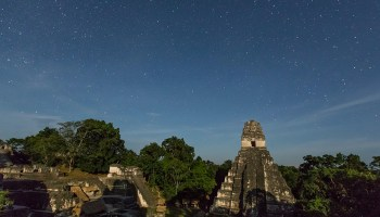Ruins of the Temple of the Jaguar under the stars.