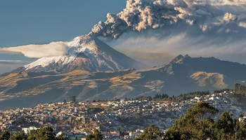 A view of Ecuador's Mejia Canton in 2015, with Cotopaxi volcano erupting in the background.