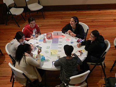 PROGRESS students from the Carolinas play a board game designed to teach the cumulative effects of subtle gender bias.