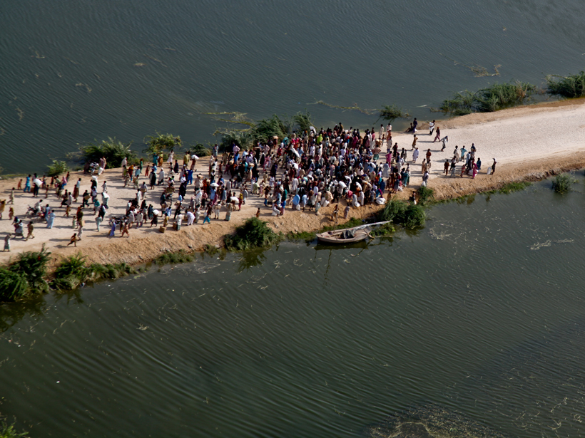 Aerial view of Pakistani flood survivors isolated on a road surrounded by water on 14 September 2010.