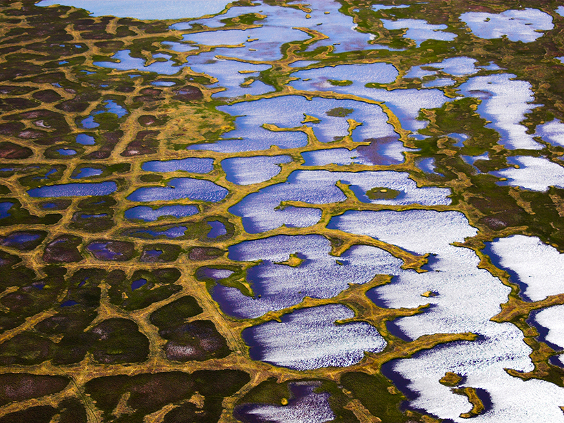 This aerial photo taken over Alaska shows one of the ways that thawing permafrost reshapes the landscape.
