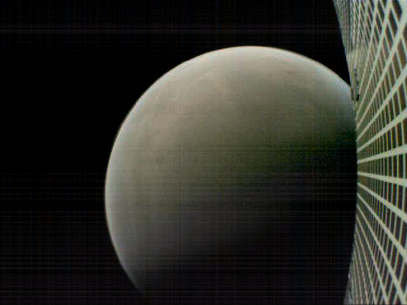 Mars and WALL-E's (MarCO-B) solar panel during flyby