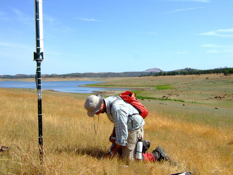 Ruzbeh Akbar installs sensors at a SoilSCAPE site in California
