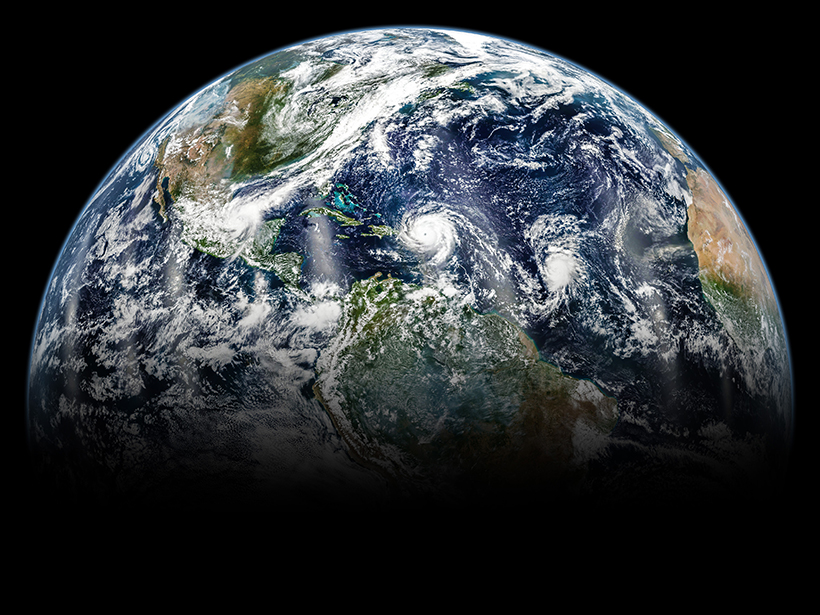 A satellite view of hurricanes swirling across Earth's Northern Hemisphere