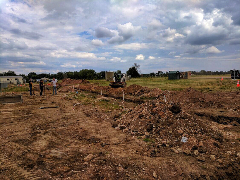 Researchers backfill testbed trenches with natural soil at METEC in Fort Collins, Colo.