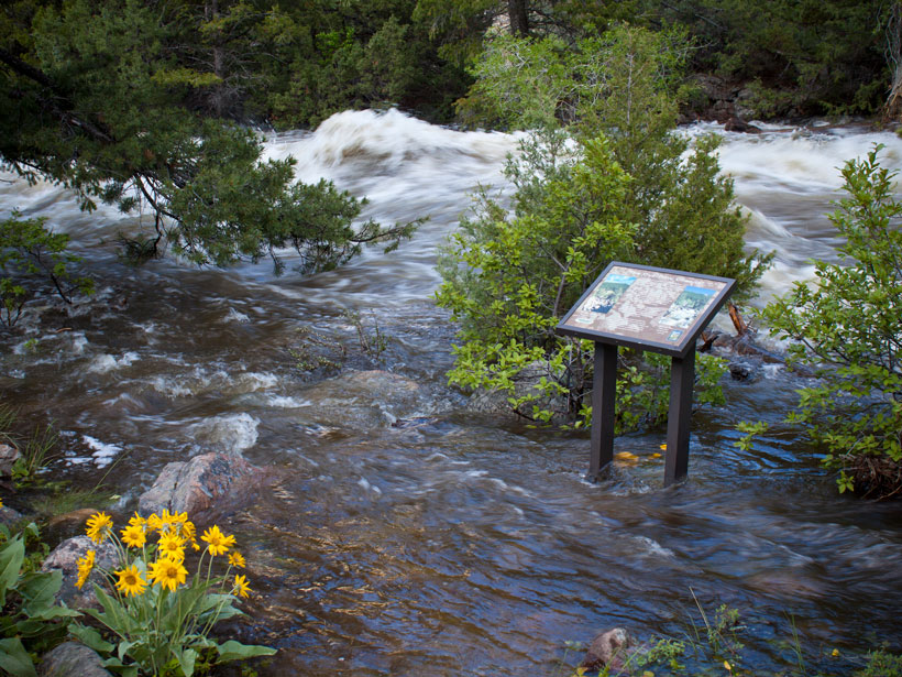 Water overflows the river channel in Sinks Canyon State Park, Wyoming