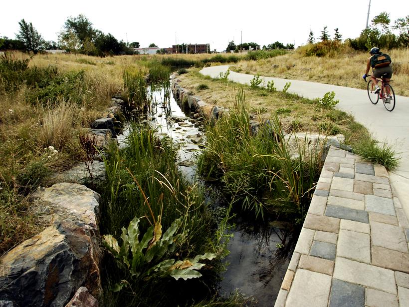 Flood mitigation methods in Boulder, Colorado along a creek-side path.