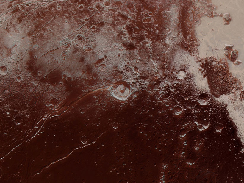 Pluto's Elliot crater and Virgil Fossae