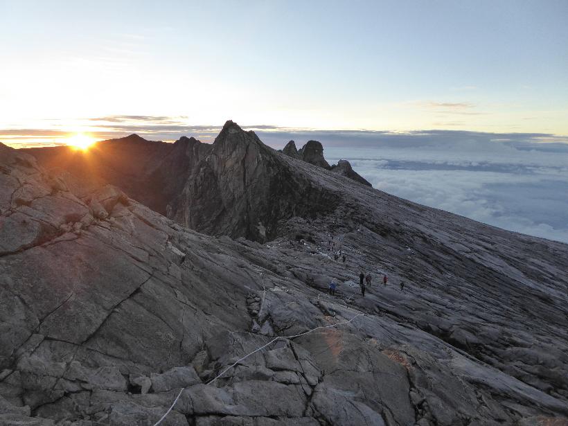 The Sun peeks over a ridge near the top of Mount Kinabalu in northern Borneo.