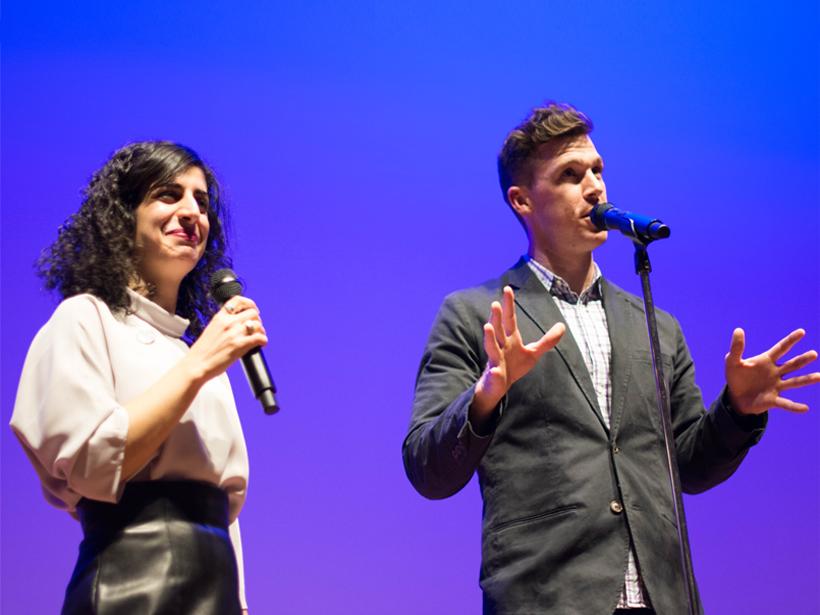 Shane Hanlon and Maryam Zaringhalam performing at The Story Collider Show at AGU Fall Meeting 2018