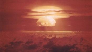 Red-hued image of a nuclear mushroom cloud