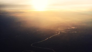 Aerial view of the Ebro River snaking into the sunset